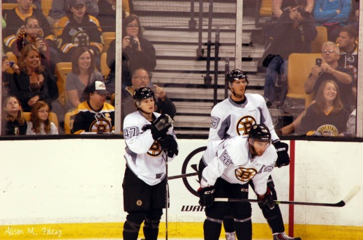 Torey Krug, David Krejci and Tommy Cross at training camp. Photo by Alison Foley