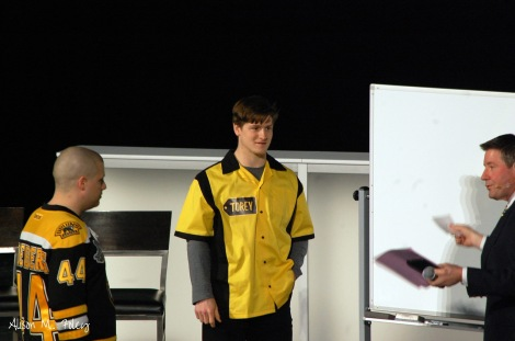 Torey Krug and a fan participate in the Bruins game show event (Photo courtesy of Alison M. Foley)