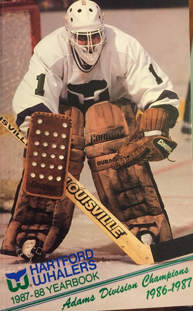 Mike Liut on the cover of the 1987-88 Hartford Whalers media guide and yearbook